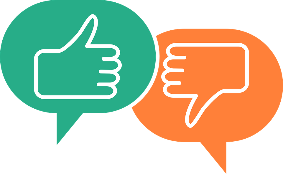 Two speech bubbles; one with a thumbs up one with a thumbs down inside.